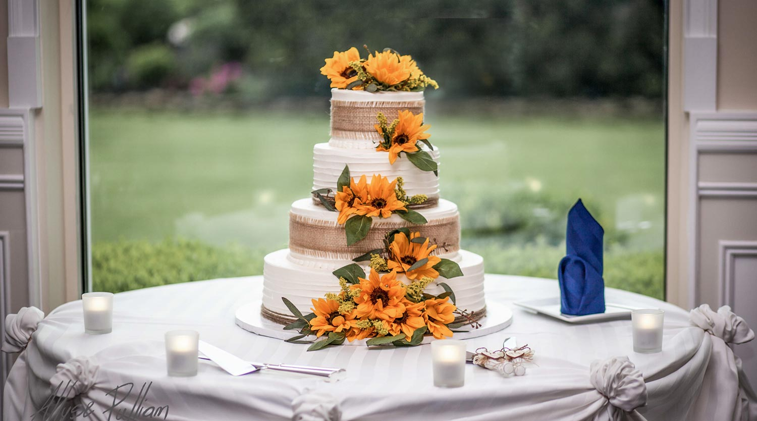 Photo: four tier Fall wedding cake with burlap and sunflowers
