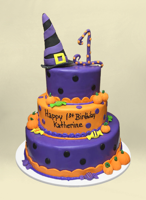 Photo: purple and orange fondant tiers with dimension pumpkins and witch hat
