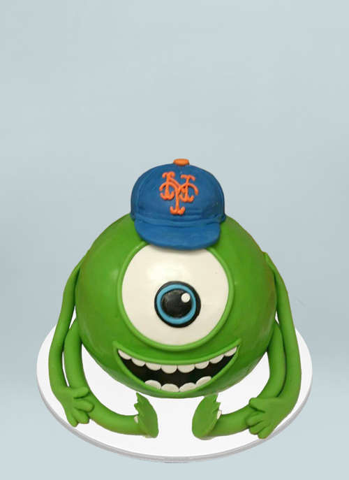 Photo: green frosted cake shaped as Mike from Monsters Inc.