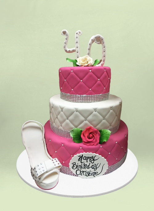 Photo: fondant cake with cushion pattern and dimentional shoe and flowers