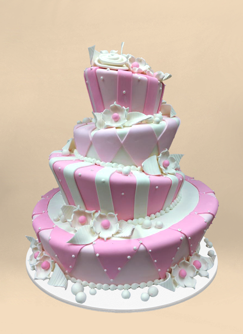 Photo: pink and white fondant patterned 4 tier topsy cake