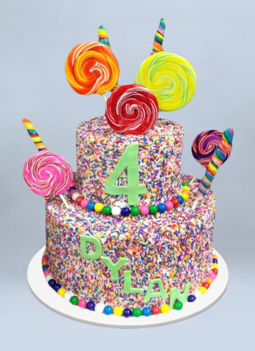 Photo: frosted cake with rainbow sprinkles and large spiral lollipops sticking out