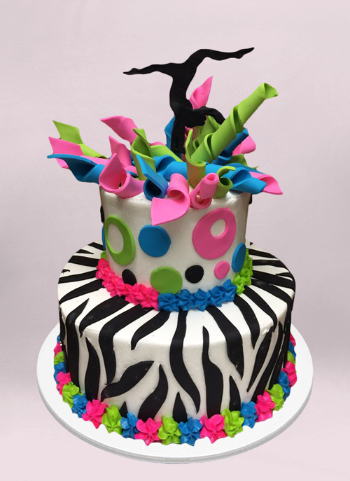 Photo: zebra pattern cake with pink, green, blue ribbons and black dancer topper