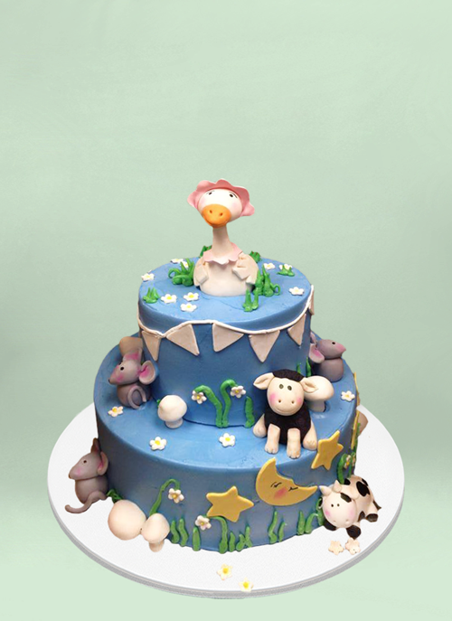 Photo: 2 tier frosted cake with fondant nursery rhyme characters placed around the tiers