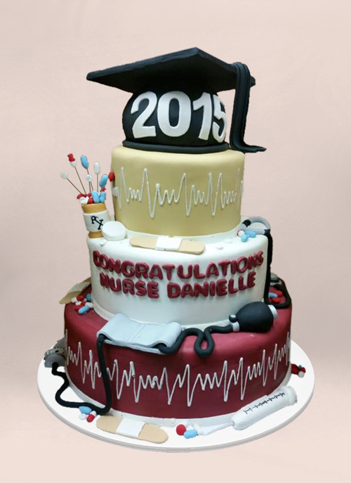 Photo: 4 tier fondant cake with dimensional grad cap and medical objects all around