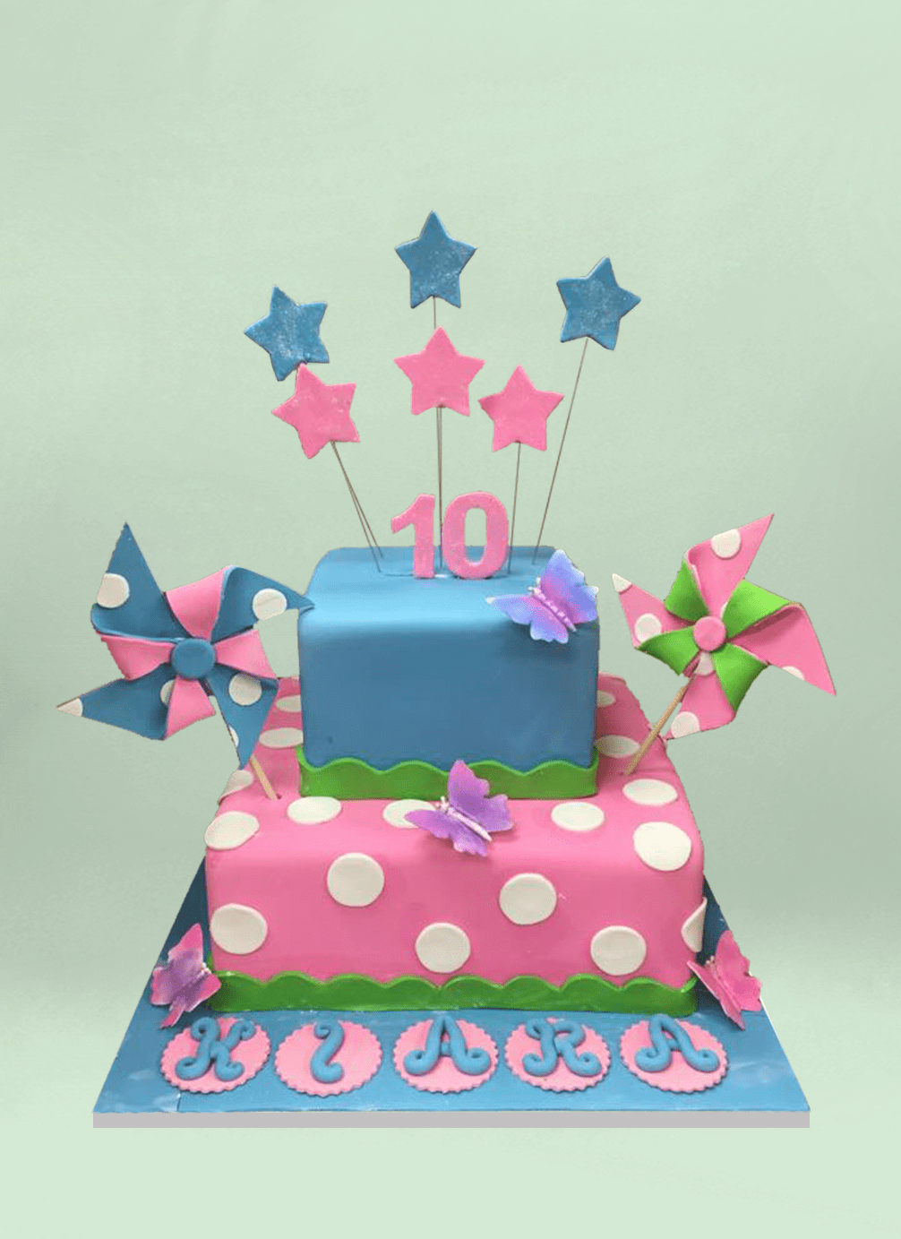Photo: square fondant cake with fondant pinwheels and stars sticking out