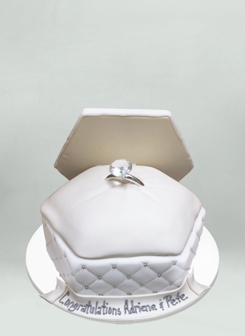 Photo: large white ring box open with large diamond ring
