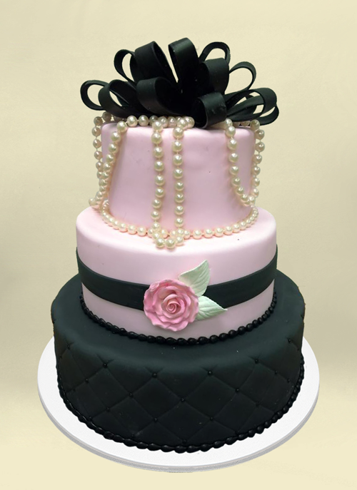 Photo:d black, pink fondant cake with frosted flower, real pears and black fondant ribbons