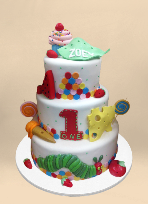 Photo: white fondant cake with fondant elements from Hungry Hungry Caterpillar around 3 tiers