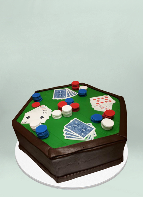 Photo: frosted octagonal cake with fondant playing cards and poker chips