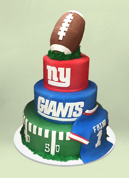 Photo: 4 tier ny giants cake with fondant jersey and football shaped top tier